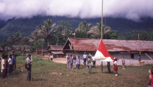 Flag raising ceremony beside the school house.