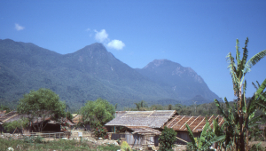 Looking back to Gunung Binaia as we walk through the enclave village of Maraina.