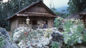 A family outside their house in the mountain village of Kanikeh.