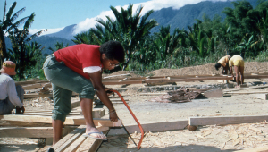 Young British venturer Denise hard at work constructing the new school in Manusela.