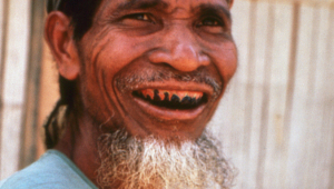 Seram elder whose teeth have been stained black by chewing on betel leaf.